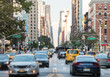 New York City busy street scene with cars and people along 3rd Avenue in the East Village of Manhattan - 207304218