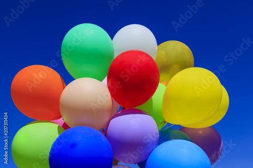 bright, colorful balls, against the blue © evgenii