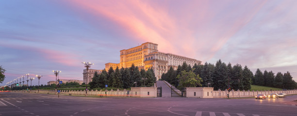 Panorama of the Palace of the Parliament, Bucharest, Romania. Colorful Sunset © tichr