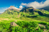 Green valley in mountains of Glencoe at sunrise, Scotland - 207328676