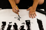 A man practicing Japanese calligraphy - 207341615