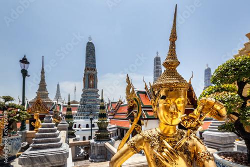 Fotobehang Bangkok Golden statue and temple details at the Grand Palace in Bangkok, Thailand