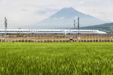 Shizuoka - July 03 : Shinkansen bullet train and Mountain Fuji on July 03 , 2017 , Shizuoka ,Japan. Shinkansen is world's busiest high-speed railway operated by four Japan Railways companies.