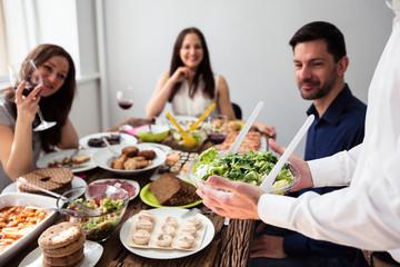 Waiter Holding Bowl Of Salad