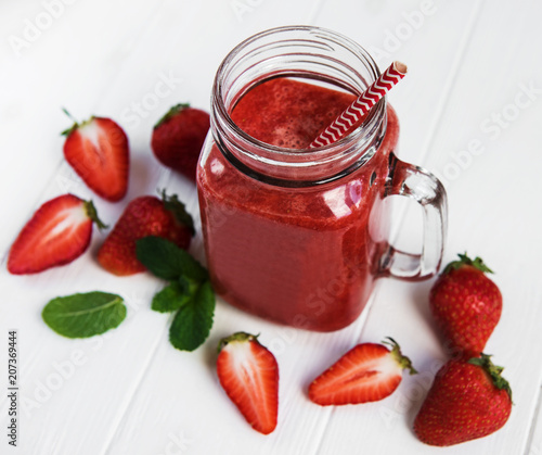 Jar with strawberry smoothie © almaje