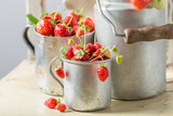 Healthy and fresh wild strawberries in the old metal mug - 207374433
