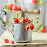 Closeup of sweet wild strawberries on the old white chair - 207374446
