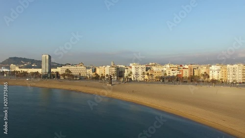 Drone shot of buildings at Barcelona beach at sunrise