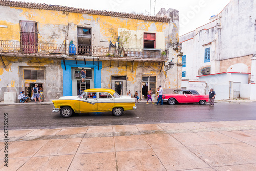 CUBA, HAVANA - MAY 5, 2017: American retro cars on city street. Copy space for text.