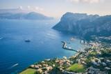 Scenic view of the dramatic coastline of the Mediterranean island of Capri across to the Almalfi coast of mainland Italy - 207392881