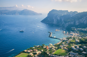 Scenic view of the dramatic coastline of the Mediterranean island of Capri across to the Almalfi coast of mainland Italy