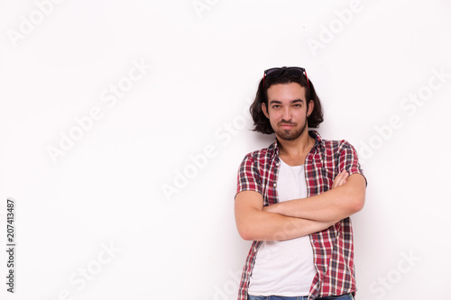 Handsome bearded man in casual clothes, looking at camera .