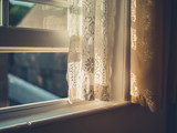 Sunlight hitting curtain by window