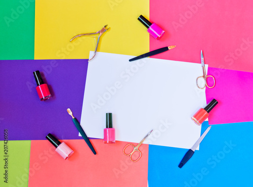 Fotobehang Pedicure Manicure or pedicure equipment and nail polishes on colorful background. Top view with copy space.