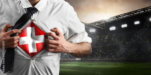 Fotobehang Voetbal Switzerland soccer or football supporter showing flag under his business shirt on stadium.