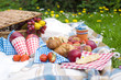 Two wine goblets, fresh strawberry, honey and wine are served for summer romantic picnicPicnic Basket with apples and bread. Family disfocused. Copy space. - 207459284