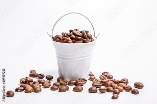 Fotobehang Koffiebonen Grains of coffee in a bucket