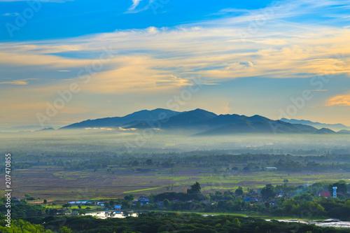 Fotobehang Beige mountain landscape and fog