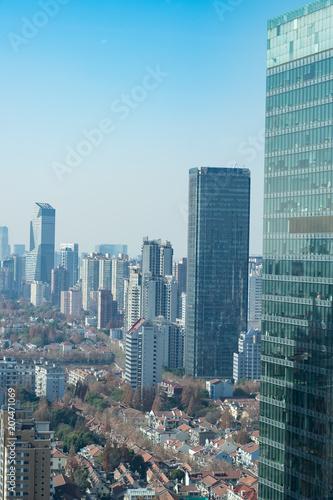Residential buildings amongst sky scrapers - Shanghai © Larry Zhou