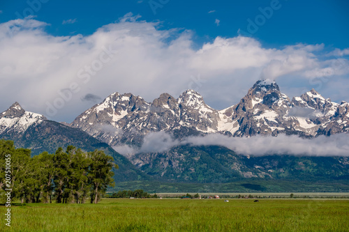 Fotobehang Donkergrijs Grand Teton Mountains with low clouds