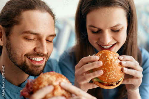 Friends Eating Burgers Indoors - 207516460
