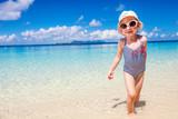 Adorable little girl at beach - 207534607