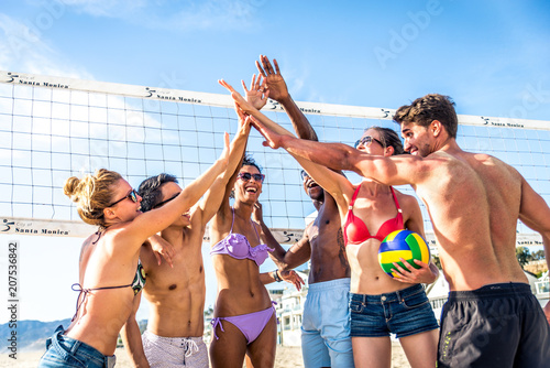 Friends play beach volley