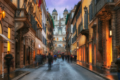 Evening view of old cozy street near Spanish Steps in Rome, Italy. Architecture and landmark of Rome. Night cityscape of Rome.