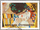 Detail from the Kiss by Klimt on austrian stamp - 207544052