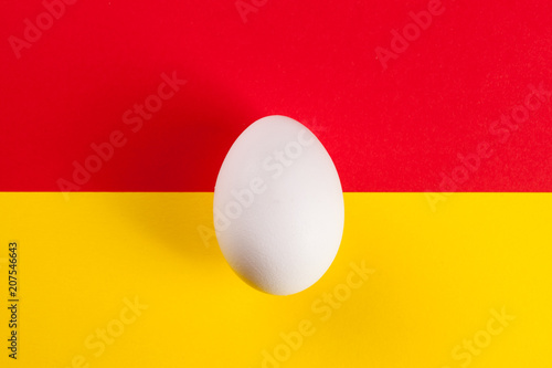 white egg on a color background - 207546643
