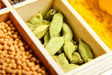 Green cardamom or cardamon seeds. Various dry spices - 207553836