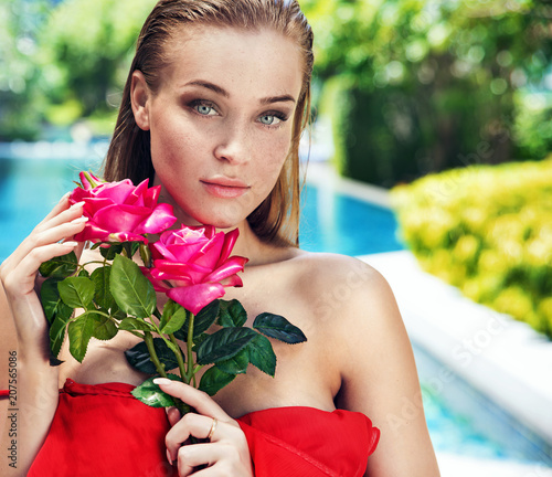 Fotobehang Konrad B. Beautiful young lady holding a bouquet of roses