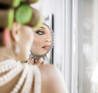 Portrait of a pretty woman doing a makeup