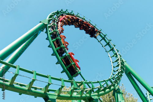 Fotobehang Amusementspark Loop rollercoaster fun ride at amusement park