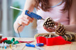 Woman doiing DIY festive decorations at home