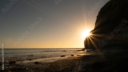 Fotobehang Zonsopgang Beautiful beach sunrise shot during coastal hike to Cape Kidnappers located in Hawke´s bay, North Island area of New Zealand