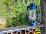Old blue lantern on the fence of a porch in a tropical setting- selective focus, vintage - 207578241