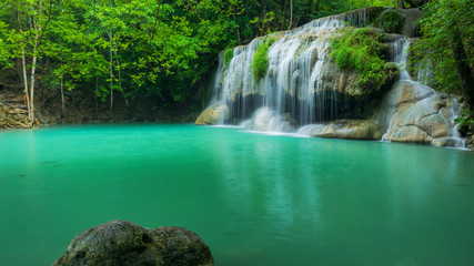 Breathtaking green waterfall at tropical rain forest, Erawan waterfall located Kanchanaburi Province, Thailand © peangdao
