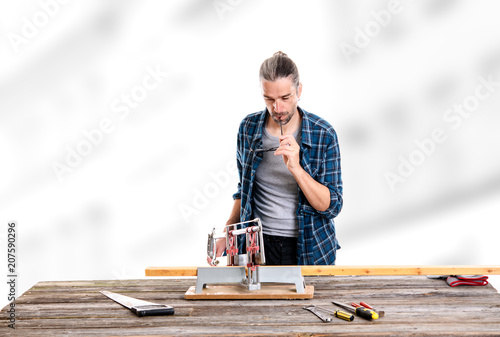 worker in blue shirt sawing wood