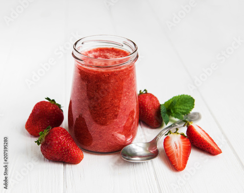 Leinwanddruck Bild Jar with strawberry smoothie