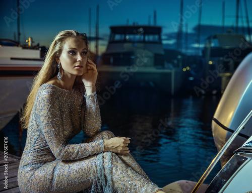 Fotobehang Konrad B. Elegant, beautiful lady resting in tropical port