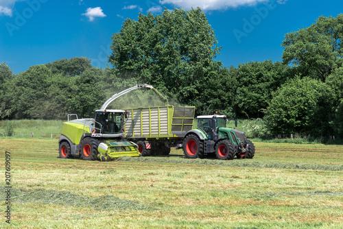 Fotobehang Trekker Farm machines at the hay harvest | 8897
