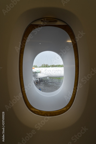 The window in the cabin of passenger aircraft. - 207610028