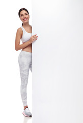 beautiful fit woman standing and holding white board © Viorel Sima
