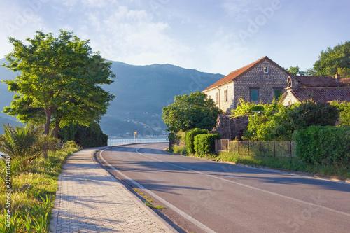 Canvas Blauwe hemel Sharp turn of road. View of Adriatic Highway (Jadranska magistrala) running along the coast of Bay of Kotor . Montenegro, Donja Lastva village