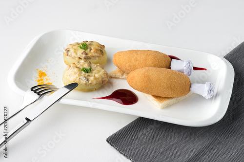 Aluminium Kiev Chicken Kiev cutlets with potato, mushrooms and decoration on white plate.
