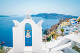 Greek whitewashed church dome with blue roof at Oia Santorini Greece