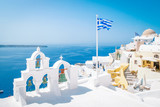 village of Oia Santorini Greece on a bright summer day - 207623251