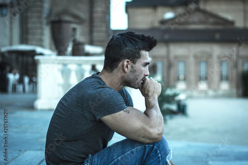 Foto Murales Handsome muscular man with tattoo posing in European city center, Turin, Italy