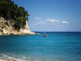 rotes Boot am Strand von Samos - 207637070